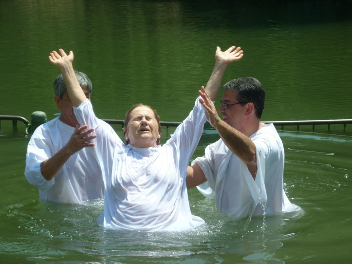 Baptism by immersion in living water.